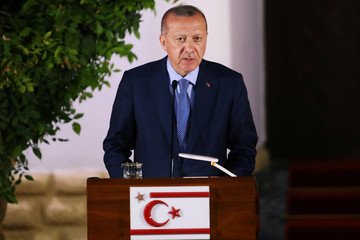 Turkish President Tayyip Erdogan talks at a press conference during a visit in the Turkish Cypriot northern part of the divided city of Nicosia