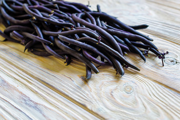 heap of france violet beans in retail vegetable super market for sale