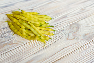 yellow beans on a wooden background.