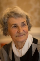 Senior woman smiling at home