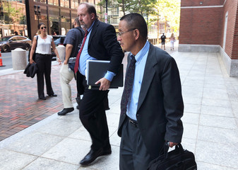 Former Akebia Therapeutics Inc employee Schultz Chan and his lawyer, Peter Horstmann, exit the federal courthouse in Boston