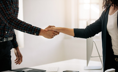 Business partners shaking hands at a meeting