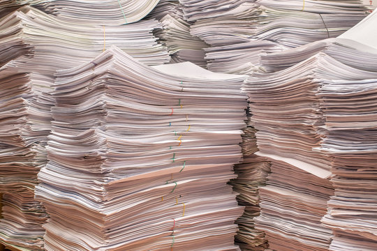 pile of paper documents in the office