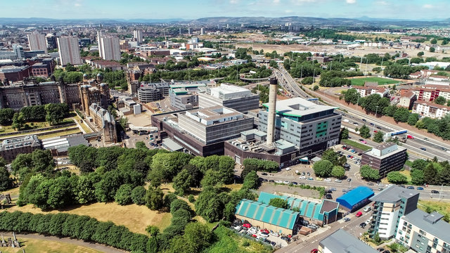 Aerial image over the new Royal Infirmary, Glasgow, with traffic on the M8.
