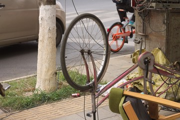 Reverse bike wheel (Kunming, Yunnan, China)