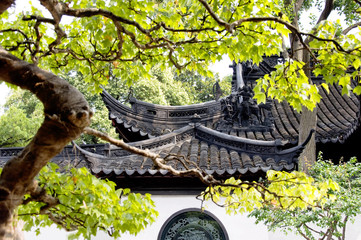 Detail of roofs at Yuyuan Gardens Yu Garden , Shanghai, China, Asia. Traditional architecture of China, an ancient tiled roof.