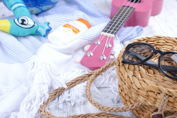 Accessories for the beach, guitar, hat and sunglasses. Good vacations.
