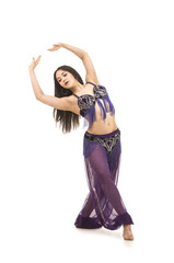 Attractive brunette girl with long hair dancing belly dance.