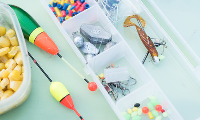 tiny elements of amateur, hobby fishing equipment including floats and corn