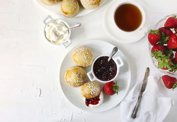 English scones with jam and whipped cream.