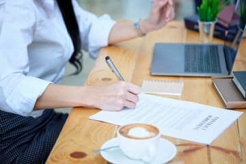 Businesswoman signing terms and conditions document paper