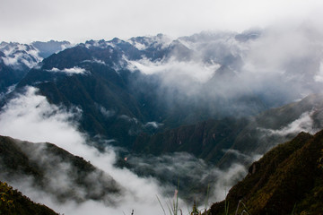 Panoramic inspirational view of the Andes mountains in mist on the Inca Trail. Peru. South America. No people.