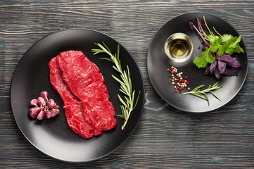 Wall Mural - Raw beef steaks marbled beef, herbs and seasonings