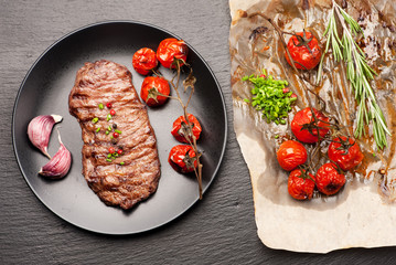Wall Mural - grilled beef steak with baked vegetables and herbs