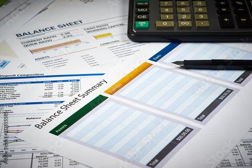 balance sheet summary and balance sheets with calculator and pen