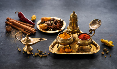 Spice, spicy and seasoning on a black concrete background. Indian food spices concept
