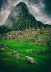 The day start with intense mist in the air in Machu Picchu. The historic archaeological site in a mysterious ambience. Beautiful wallpaper image.
