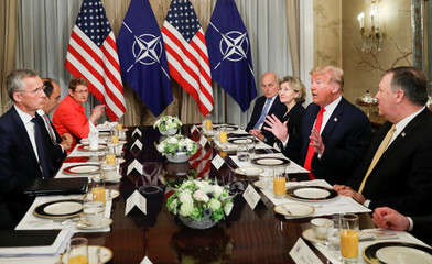U.S. President Donald Trump and NATO Secretary General Jens Stoltenberg attend a bilateral breakfast ahead of the NATO Summit in Brussels