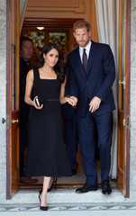Britain's Prince Harry and his wife Meghan, Duchess of Sussex, attend a reception at Glencairn, the residence of Robin Barnett, the British Ambassador to Ireland at the start of a two-day visit to Dublin