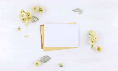 Postcard mockup whith flowers and envelope