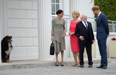 Britain's Prince Harry and Meghan, Duchess of Sussex, talk to Ireland's President, Michael Higgins, and his wife Sabina Coyne, as they pose for photographsn on the second day of a two-day visit to Dublin