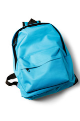 Top view of blue school backpack on white background.