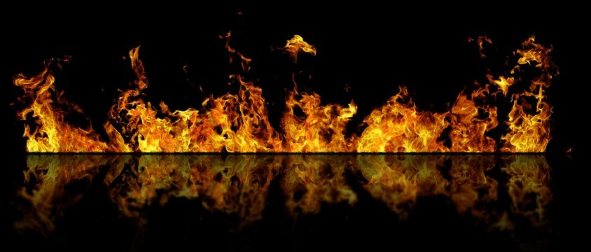 Real line of fire flames with reflection isolated on black background. Mockup on black of wall of fire.