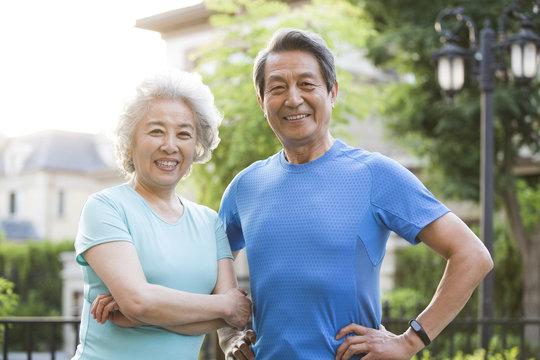 Portrait of senior couple standing outdoors