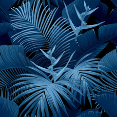 Exotic tropical background with hawaiian plants and flowers. Seamless vector indigo pattern with banana and royal palm leaves, bird of paradise flowers. Vector illustration.