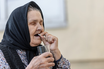 old woman takes pills