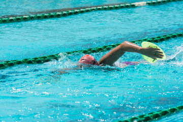 swimmer in lane pool, woman in water