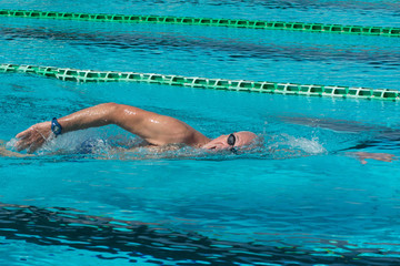 Senior man swimmer - Concept of sport and fun in swimming pool