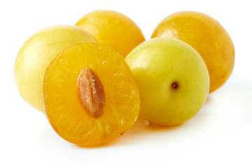 Yellow cherry plums also known as mirabelle plums isolated on white background