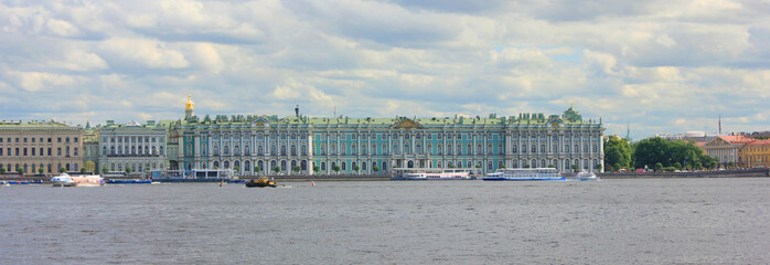 Winter Palace (Hermitage Museum) Facade Architecture View from Neva River Water. Former Official Residence of Russian Royal Family, Scenic Panorama of Building Exterior on Bright Summer Day.