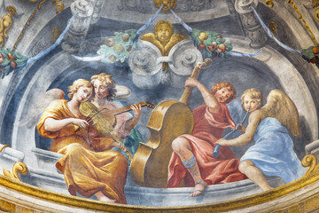 PARMA, ITALY - APRIL 15, 2018: The symbolic fresco of angels with the music instruments in church  Chiesa di Santa Cristina by Filippo Maria Galletti (1636-1714).