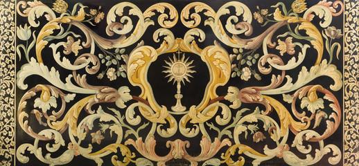 REGGIO EMILIA, ITALY - APRIL 12, 2018: The stone mosaic (Pietra Dura) with the Eucharist on the side altar in church Chiesa di Santo Stefano from 16. - 17. cent.