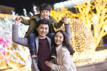 Portrait of cheerful young Chinese family