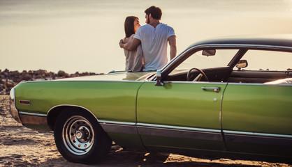 Couple with retro car