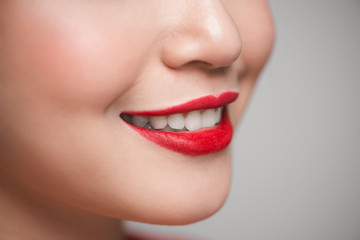 Close-up of beautiful perfect red lips. Selective focus.