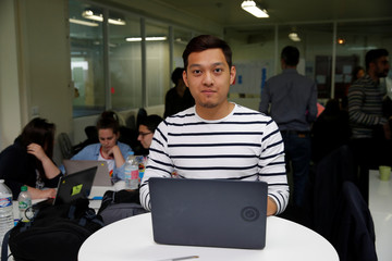 Student Nicky Hour, aged 25, poses in his web development class as part of professional training at the Simplon.co school specialized in digital sector in Montreuil, near Paris