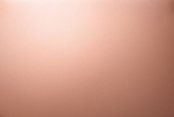 Copper texture. The smooth surface texture of metal sheet with white light glare.