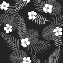 Tropical background with palm leaves and flowers. Seamless floral pattern. Summer vector illustration. Black and white