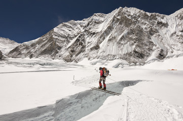 Nepal, Solo Khumbu, Everest, Sagamartha National Park, Mountaineer crossing icefall on a ladder
