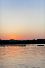Germany, Bavaria, Chiemsee, boardwalk at sunset
