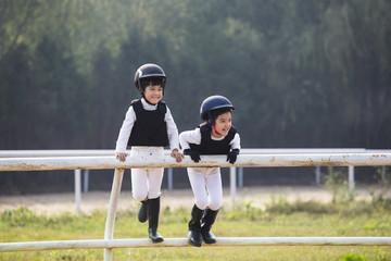 Little Chinese children taking part in equestrian club