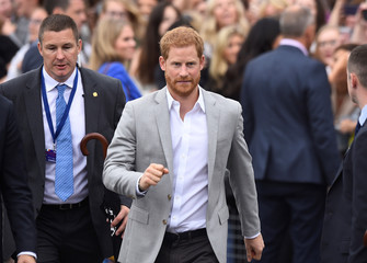Britain's Prince Harry pulls a funny face at the end of a walkabout in Parliament Square in Trinity College, Dublin