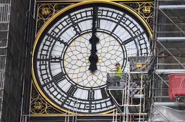 Workers replace glass panes on the clock face of Queen Elizabeth tower, commonly known as Big Ben on the Houses of Parliament, in central London