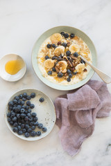 Breakfast with oats, banana and blue berries