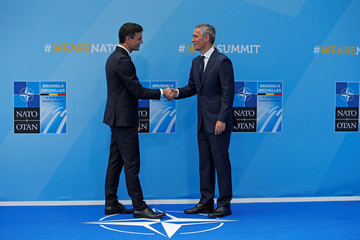Spanish Prime Minister Pedro Sanchez is greeted by NATO Secretary General Jens Stoltenberg before a summit of heads of state and government at NATO headquarters in Brussels
