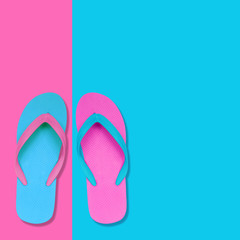 Pink and Blue Flip Flops on pastel colors background